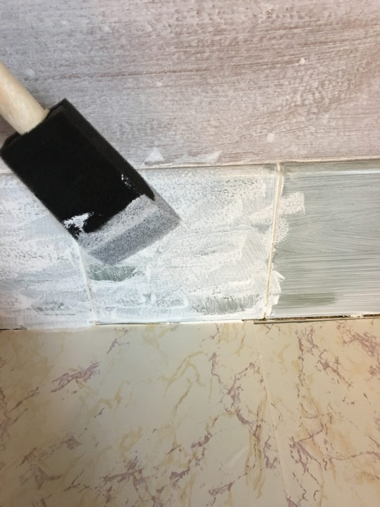 Sponging paint onto tile